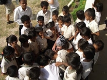 CAMBODIA:  Songs gather the children