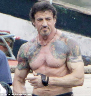 Hey look, it's Sylvester Stallone showing us his tattoos.