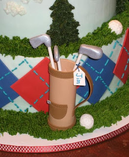 Golf birthday cake close up, golf bag and clubs