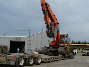 Loading excavator for trip up Steese