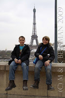 The boys in front the majestic Eiffel Tower