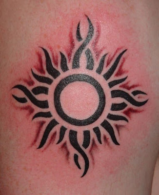 Picture of flaming tribal sun tattoo design.