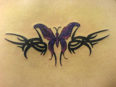 Lovely black tribal and violet butterfly tattoo design.
