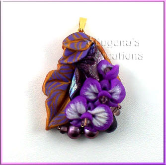 polymer clay pendant with orchids
