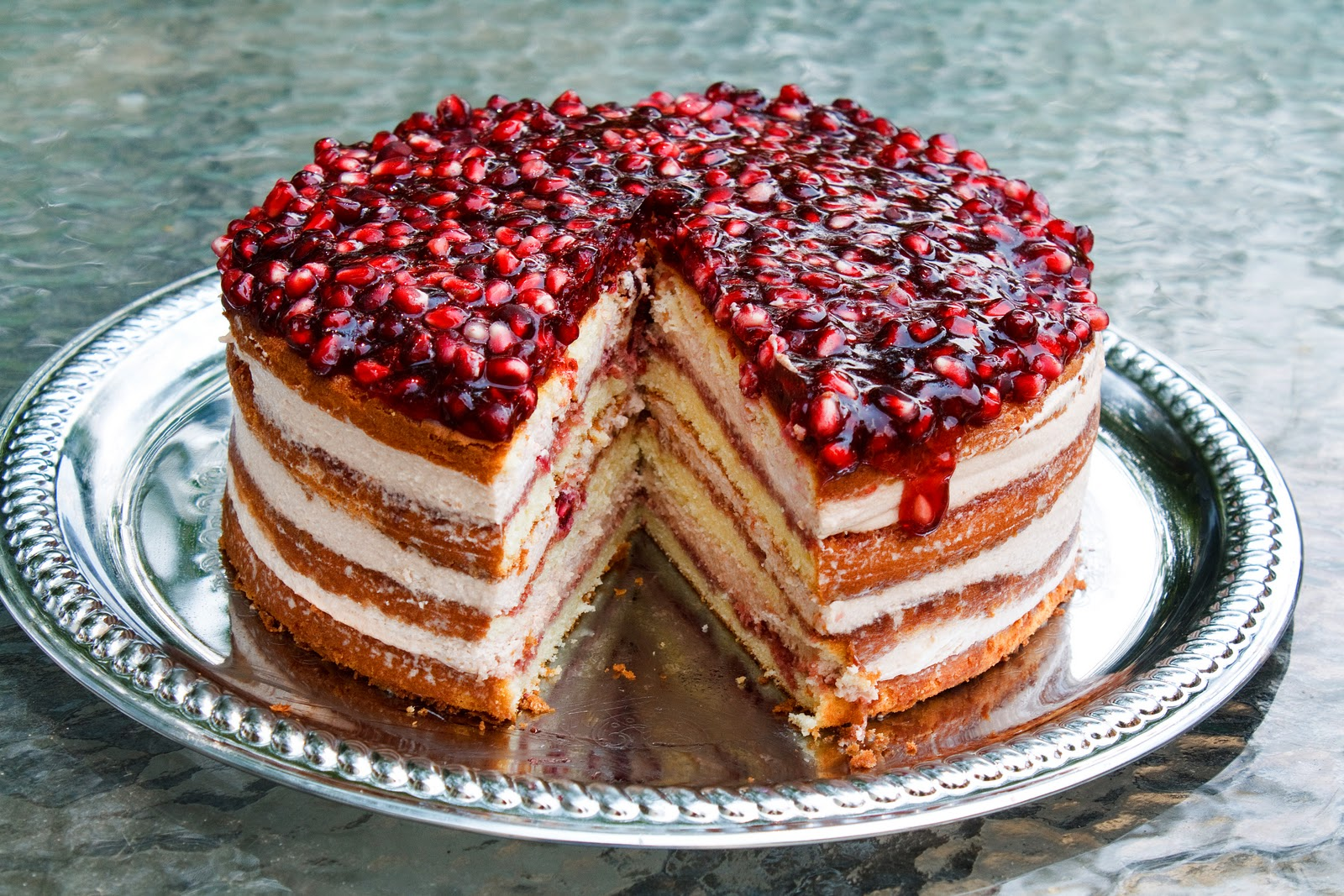 via Ask Chef Dennis http://www.askchefdennis.com/2010/06/theyll-be-eating-out-of-the-pom-of-your-hand-pomegranate-mousse-cake/