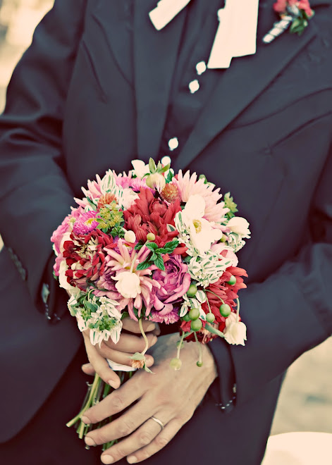 the groom with bride's bouquet