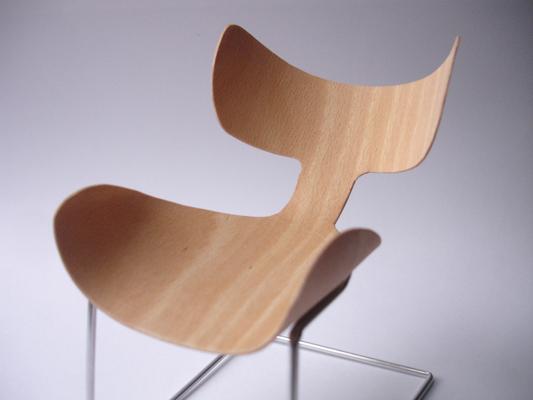 propuesta presentada al concurso de diseo de andreu world consiste en un silln ligero de formas orgnicas envolventes con marcado carcter clido y