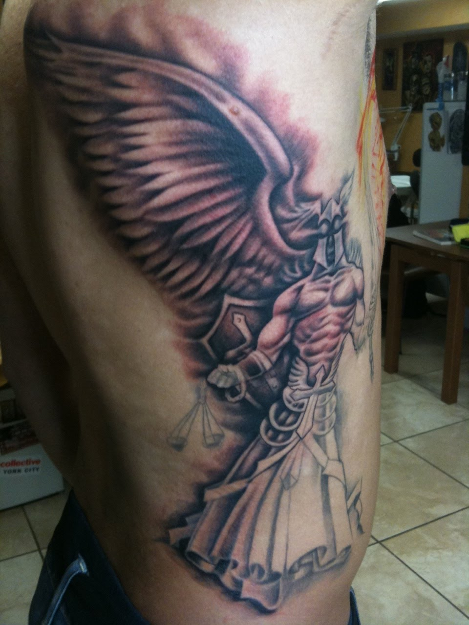 Freehand archangel of justice tattoo in progress.