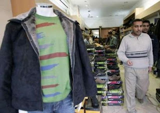 Residents shop for clothes and shoes in Baghdad's Karrada commercial district December 8, 2007