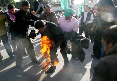 Journalists Under Fire… Gaza Cameraman Seriously Burned Filming Flag Torching Protest