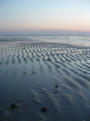 rippled sand and ocean water at cape cod beach