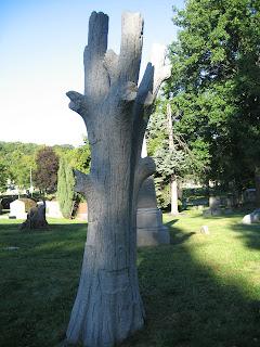 tree trunk headstone