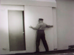 A Civil Defense Guard Closes Up The Bunker Entrance Doors