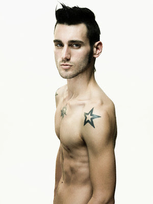 Star Tattoo Black shoulder star tattoo on good looking male's.