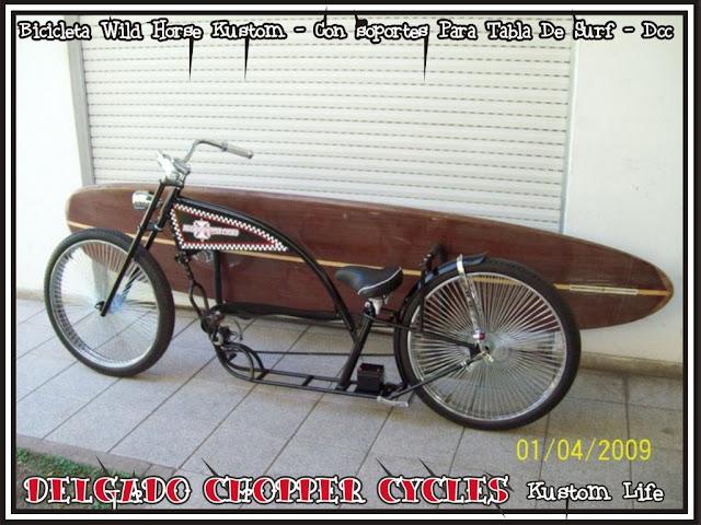 Bicicleta Wild Horse Kustom con soportes para tabla de surf