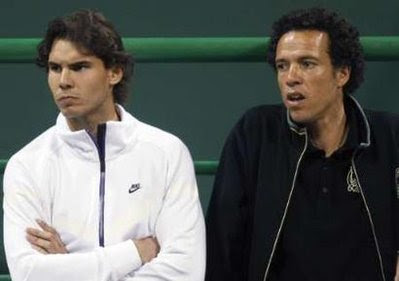 Black Tennis Pro's Younes El Aynaoui and Rafael Nadal watch Roger Federer in semifinal round at Qatar Open
