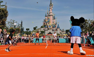 Black Tennis Pro's Gael Monfils, Stanislas Wawrinka and Mickey Mouse playing doubles Disneyland Paris