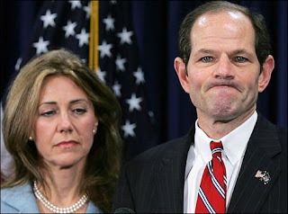 New York Governor Eliot Spitzer addresses the media with his wife Silda Wall Spitzer at his office in New York, March 10, 2008 - photo by Shannon Stapleton/REUTERS