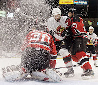 Brodeur gets snowed under, Devils vs. Senators 4/26/2007 Courtesy of Getty Images