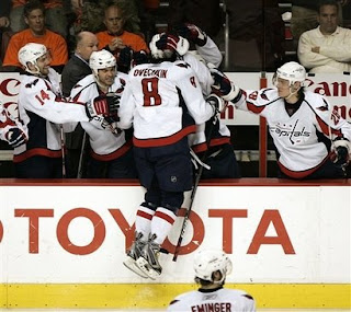 Washington Capitals' Alexander Ovechkin, of Russia, jumps into the arms of his teammates after scoring the first of his two goals in the third period of Game 6 of the Eastern Conference quarter final hockey playoffs with the Philadelphia Flyers, Monday, April 21, 2008, in Philadelphia. The Capitals won 4-2 tying the series 3-3. <br />(AP Photo/Tom Mihalek)