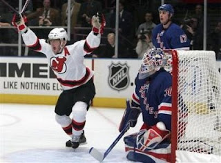 New Jersey Devils John Madden (L) celebrates his overtime goal against the New York Rangers goalie Henrik Lundqvist during Game 3 of their NHL Eastern Conference quarterfinal hockey game in New York, April 13, 2008. (Shannon Stapleton/Reuters)