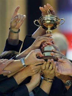Members of the U.S. team hold up the Ryder Cup trophy after winning the golf tournament at Valhalla Golf Club, in Louisville, Ky., Sunday, Sept. 21, 2008. (AP Photo/David J. Phillip)