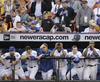The New York Mets line the dugout steps during their 4-2 loss to the Florida Marlins in their final game of the season at Shea Stadium in New York on Sunday, Sept. 28, 2008. (AP Photo/Julie Jacobson)