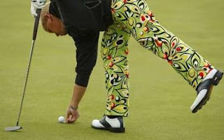 John Daly of the U.S. marks his ball on the sixth green during the second round of the British Open Golf Championship at the Turnberry Golf Club in Scotland, July 17, 2009.<br />REUTERS/Mike Blake (BRITAIN SPORT GOLF)