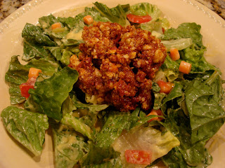 "Raw Vegan Taco Nut ""Meat"" over salad"