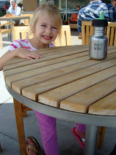 Smiling child sitting at table
