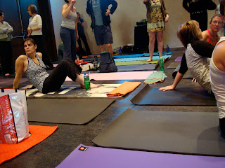 Various people on yoga mats