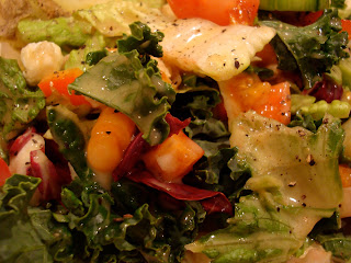 Close up of salad topped with Vegan Holiday-Spice Orange Vinaigrette