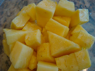 Diced up pineapple in container