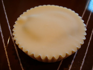 Vegan White Chocolate Chocolate-Peanut Butter Cup on brown plate