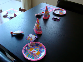 Birthday Party Plates and hats on table