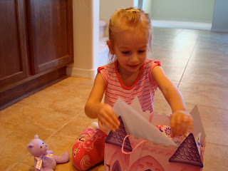 Young girl opening birthday presents