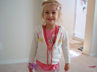 Young girl standing up showing her being dressed up