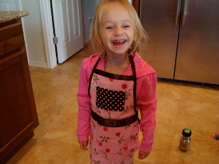 Young girl in apron smiling