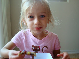 Young girl sitting eating cookies
