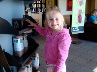 Young girl smiling at coffee display at Starbucks