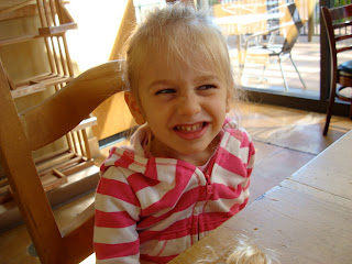 Young girl making silly face at table