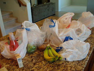 Various plastic grocery bags on countertop