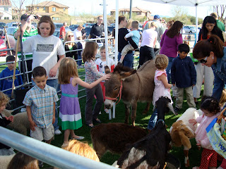 Crowd of children at petting zoo