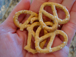 Hand holding pretzels