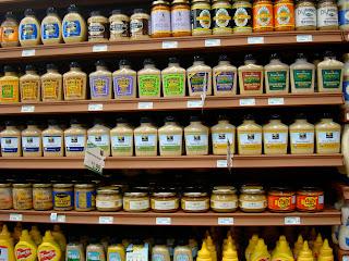 Shelves full of various mustards