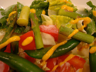 Mixed vegetables topped with yellow mustard