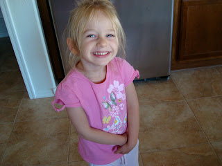 Little girl standing in kitchen smiling