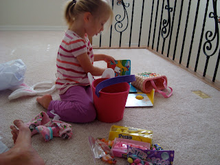 Young girl with candy laid out going through basket