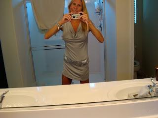 Woman taking photo in grey dress
