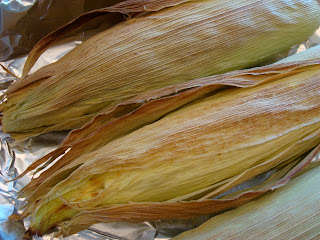 Close up of corn husks in baking pan